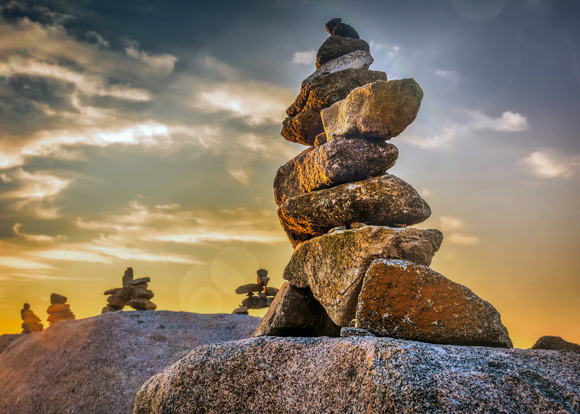 PH5VE training, workshops and conference speaking - Building meaning. A foundation that holds up any ambition. Above and beyond (Inuksuk Canada Peggy Cove)